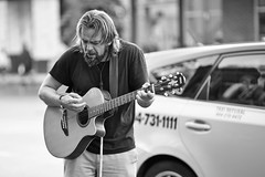 Nirvana (dVaffection) Tags: street vancouver nirvana urbanlife urban busker granville black blackandwhite white bw downtown portrait city guitar taxi face song singer cross canada