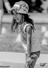 little girl (discreet*(:[ )) Tags: little girl canon tamron 7d 70300mm mark ii queen elizabeth photography prime photo park portrait people photooftheday zoom lens bokeh black white discreet dof depth field f456 hat pose noon street
