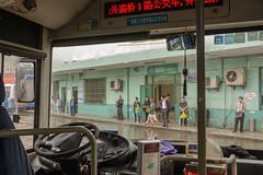 Bus stop (stevefge) Tags: binjiangforrestpark china shanghai people rain wet candid bus street reflectyourworld
