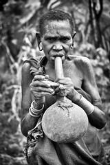 Pipe Smoker, Surmi (Rod Waddington) Tags: africa african afrika afrique ethiopia ethiopian ethnic etiopia ethnicity ethiopie etiopian thiopien tulgit omovalley omo omoriver surmi surma tribe traditional tribal pipe smoker smoking calabash woman female blackandwhite culture