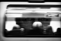 all eyes on us (bostankorkulugu) Tags: jamesblunt chancerylane eyes face picture ad billboard train commuters metro metrostation underground tube subway poster blur blurry motionblur london england station undergroundstation streetphotography uk londonstreets blackandwhite wall unitedkingdom greatbritain korkut bostan bostanci bostankorkulugu blackwhite bw monochrome sepia street photography