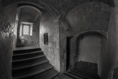 Down the Stairs - Bolsover Castle (AngelCrutch) Tags: bolsovercastle bolsover derbyshire england englishheritage britishhistory historicbuilding castle stonebuilding stairs windows blackandwhite uk