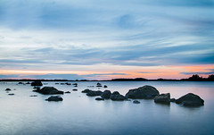 Line of stones (Jeanette Svensson) Tags: alt 0651 0586 sweden smland summer jeanettesvensson sunset mckelns badplats lake stones color sky cloud mirror smooth longexposure happy jeanettesvenssonphotography silent peaceful