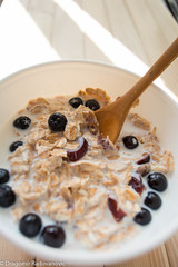 Healthy breakfast with aronia (radebg) Tags: cup aronia beverage milk muesli blue delicious homemade cereal black spelta chokeberry fruit spoon wooden breakfast apple healthy tasty morning drink food rice bowl blueberry sunny eating cornflakes dairy table meal juice white