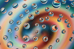 Psychedelic drops (Lorraine1234) Tags: drops colors macro refraction