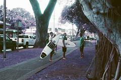 Surfers, Lahaina, Maui (bloodyeyeballs) Tags: lomochrome lomochromepurple film 35mmfilm filmphotography filmisnotdead analogue buyfilmnotmegapixels ishootfilm staybrokeshootfilm thefilmcommunity leica leicam3 summilux50 hawaii maui lahaina streetphotography streetphoto leicam purple lomography lomographypurple surfers surfboards
