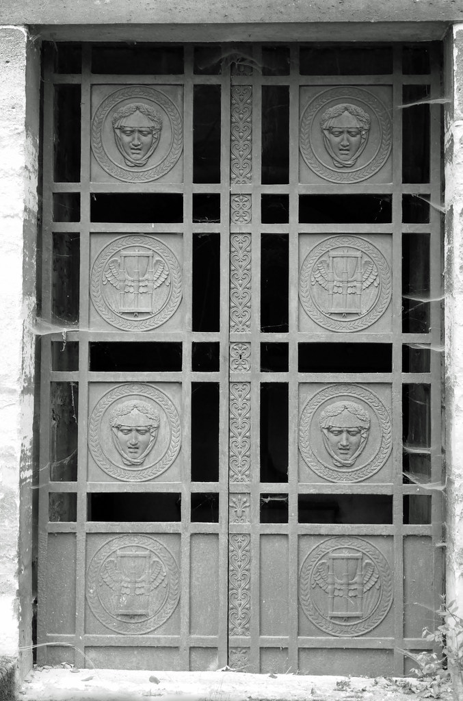 Mourning women\u0027s faces and winged hourglasses - metal door of a mausoleum (Monceau) Tags & The World\u0027s Best Photos of hourglass and winged - Flickr Hive Mind