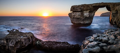 Azure Window - San Lawrenz, Malta - Seascape photography (Giuseppe Milo (www.pixael.com)) Tags: longexposure travel light sunset sea sky panorama orange cliff sun seascape motion nature yellow clouds landscape geotagged photography photo rocks europe fuji mt malta fujifilm onsale ultrawide azurewindow sanlawrenz fujix xe2 fuji14 fuji14mm fujixe2