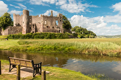 Laugharne Castle (Keith in Exeter) Tags: castle laugharne carmarthenshire wales landscape heritage water estuary fort fortified ruins reeds trees seat bench outdoor castellations tower