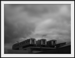 easey's trains (Andrew C Wallace) Tags: blackandwhite bw rooftop bar lensbaby train ir cafe collingwood australia diner olympus victoria infrared carriages tiltshift m43 nikon50mmf14 easeystreet microfourthirds tilttransformer olympusomdem5 easeysburgers