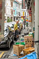 I'll just tidy up shall I? (dave.fergy) Tags: people holidays events street working employment work singapore sg