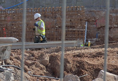 Repairing The Sea Wall, Exmouth. Devon. (ManOfYorkshire) Tags: workman hardhat singlasses shades vest hiviz sea wall repairs building exmouth devon wire reinforcement concrete stone foundations boots guy tapemeasure structure jeans gloves
