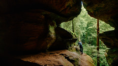 Gazing out of a Window at the Rock House (MightyBoyBrian) Tags: bracketedimage rockhouse ohiostate hockinghills riskybusiness handheld hdrpanorama ohiostatepark bouldering mennonite hdr bracketed
