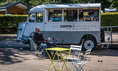 2016 - Baltic Cruise - Roskilde - Viking Museum  3 of 3 (Ted's photos - For Me & You) Tags: 2016 balticcruise tedmcgrath tedsphotos roskilde roskildedenmark denmark cropped vignetting foodtruck seating seated van kaffe tables wheels tires denim denimjeans