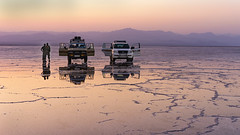 Exploring the Salt Flats in Northern Ethiopia and the Hottest Place on Earth (departing(YYZ)) Tags: africa travel pink sunset people mountains reflection zeiss landscape purple 4x4 unique empty sony horizon extreme transport adventure exotic 55mm journey toyota land remote ethiopia alpha suv landrover saline saltflats cruiser a7 harsh eastafrica geologic greatriftvalley danakildepression sonnartfe55mmf18zalens