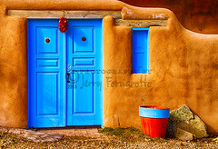 Taos Doorway (Jerry Fornarotto) Tags: door wood old travel blue red food house newmexico santafe southwest building window wall architecture rural outdoors chili turquoise spice rustic pueblo decoration entrance culture lifestyle style dry wm adobe hanging taos decor watermark ristra chilipepper mexicanculture sonya7r