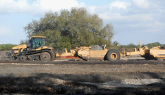 Sarasota Construction - Caterpillar Tractor and Scrapers (roger4336) Tags: tractor cat florida cobblestone caterpillar mackenzie sarasota scraper subdivision 2015 palmerranch tracktype