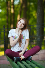 (Serge Zap) Tags: female woman park bench girl young beautiful outside person beauty pretty adult outdoor casual people one happy student sitting smile cute caucasian lady lifestyle relaxed real adorable attractive portrait nature spring summer long hair ginger candid freckles foliage shallow depph field fun crossed legs trendy