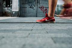 Just do it already. (ewitsoe) Tags: ewitsoe nike nikon d80 35mm street level lowdof brand brands advertisement running motion blur erikwitsoe campaign shoes shoe red redshoe jog active workout man walking urbna city cityscape life citylife