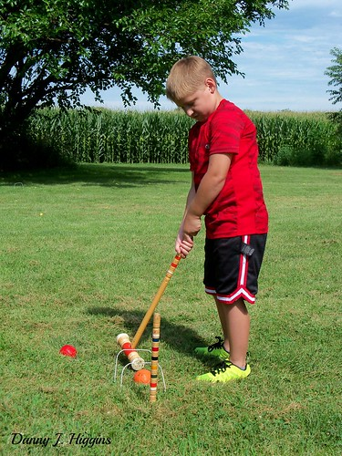 Joey Playing Croquet.  100_6419
