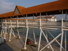 Traditional styling at Port Klang (Ben Zabulis) Tags: portklang asia malaysia southeastasia fareast pulauindah bousteadcruisecentre walkway linkbridge port harbour wharf quay roof rooftiles steel steelwork handrail 5photosaday cruise cruising quayside pitchedroof tiles columns bracing
