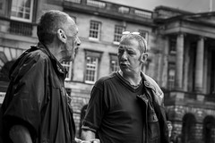 A Difference Of Opinion (Leanne Boulton) Tags: monochrome people urban street candid portrait streetphotography candidstreetphotography streetlife man men male face faces facial expression gesture interaction disagreement emotion mood feeling look tone texture detail depthoffield bokeh natural outdoor light shade shadow city scene human life living humanity society culture canon 7d 50mm black white blackwhite bw mono blackandwhite character edinburgh scotland uk dutchangle