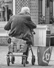 Necessary shopping stop (andzwe) Tags: senior rollator boodschappen ah groceries parked bag dwingeloo dutch blackandwhite monochrome portrait shopping shoppingbag tas bread brood albertheijn fanelli ijssalon old oldage ouderdom rust timeout