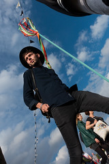 (jaumescar) Tags: festival music man walking black wear sky low pow hat light color guy contrast london park human people vertical