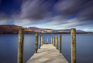 Ashness jetty with a snow capped Catbells ridge in the distance. Derwentwater, Lake District, England. UK