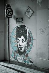 Paris, 2012. (Jorge Eduardo Albarracin) Tags: street woman paris muro art wall 50mm graffiti calle mujer day wand strasse montmartre frau passage mur dis abbesses