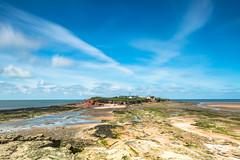 Hilbre Island from Middle Eye (WilliamJW46) Tags: ocean longexposure blue england sky water clouds island rocks unitedkingdom shoreline wirral hilbreisland