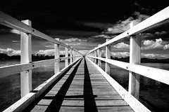 Walk this way... (ImagesByLin) Tags: bridge blue holiday geometric water monochrome clouds contrast canon mono blackwhite geometry walkway southwestrocks leadingline vanishingbpoint