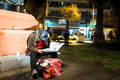 (. . .) Tags: chile life street city red people man night reading lights valparaiso newspaper photojournalism daily sit 2016 documentalism