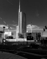 """Unicredit Tower"" (giannipaoloziliani) Tags: street city sky urban blackandwhite italy trafficlights milan tower cars architecture clouds skyscraper buildings walking advertising lights downtown afternoon traffic live milano centre sunday streetphotography streetlife monochromatic business streetphoto roadsigns roads today lombardia armani mycity veryhot worksinprogress mailand unicredit urbanstreet portanuova streetlive metropoli citylive businesscentre silverlight businessarea milancity unicredittower giannipaoloziliani"