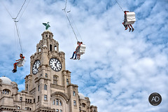 Revolutions, fast or slow, but one takes time! (alun.disley@ntlworld.com) Tags: liverpool liverpoolwaterfront fairgroundattraction royalliverbuilding clocks clocktower architecture people sky weather portsandharbours clouds fun