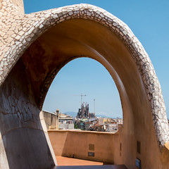Gaudi through Gaudi (D-j-L) Tags: barcelona spain gaudi lapedrera sagradafamilia architecture buildings day arch tiles spires cathedral sky canon s100