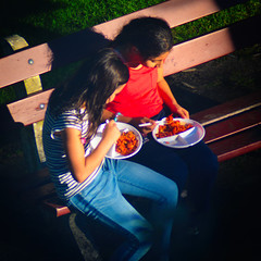 Together (Arthur Koek) Tags: girls kids sitting bench eating food plates sunset harderwijk veluwe gelderland thenetherlands