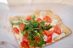 Pizza from Savini (crafty--fox) Tags: italy food tomato yum bright tasty pizza rocket siena takeaway oliveoil travelfood