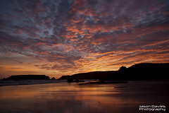 Marloes sands (Jason Davies Photography) Tags: sunset sky tourism beach silhouette clouds canon reflections landscape outdoors photography coast seaside rocks westwales colours outdoor coastline ripples pembrokeshire wetsand beachscape pembrokeshirecoast pembrokeshirewales canonphotography sigmalenses visitwales marloessands canon1000d sigma1850f2845 visitpembrokeshire jasondaviesphotography marloessandssunset