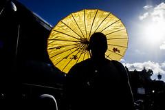 yellow, blue and black (michele liberti) Tags: streetphotography streetcolors colors umbrella lightandshadow light shadow black yellow blu sky darkcolor naples napoli italy