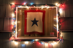 Star in the Window (Curtis Gregory Perry) Tags: christmas longexposure blue our light red white window glass night oregon sisters for star nikon sticker flag pray banner july american service fourth troops d800e