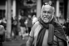 Just a regular guy. (Just Ard) Tags: man eyecontact sweater beard people person face street photography candid unposed black white mono monochrome bw blackandwhite noiretblanc biancoenero schwarzundweis zwartwit blancoynegro  justard nikon d750 85mm whiskers depthoffield