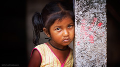 Sanjana (kevinkishore) Tags: child children portrait life people innocence eyes face india village rural outdoor pennalur