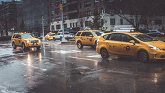 A New York Minute (Thad Zajdowicz) Tags: nyc newyorkcity parkavenue rain weather christmaseve taxi cab cars automobiles wet travel hurry bustle zajdowicz leica lightroom availablelight outdoor outside street urban city concept iconic car vehicle light shadow reflection newyorkminute