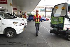 manila petrol station (DOLCEVITALUX) Tags: petrolstation manilapetrolstation manila philippines motorcycle motorbike canonpowershotsx50hs