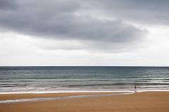 Gijn-Xixn- (Carles Cerulla) Tags: gijnxixnplaya silueta asturias norte espaa bruma olas color virado sepia paraguas personas canon 5 d