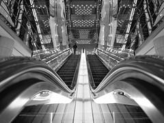 Labyrinth (marco ferrarin) Tags: urban blackandwhite reflection building glass monochrome japan composition tokyo ginza mirror space escalator olympus marion symmetry labyrinth yurakucho  em5 marcoferrarin