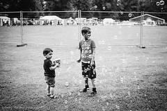 Bubbles (gwpics) Tags: fun bubbles joy people mono children english mela leicam7 indian britain pleasure leisure boy streetphotography england southampton greatbritain uk play blackwhite blackandwhite child film hampshire kid kids lad monochrome person relaxation socialcomment socialdocumentary society strasenfotograpfie unitedkingdom youth bw lifestyle relax relaxing streetpics