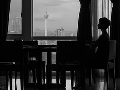 Room with a view (4tun8bug) Tags: windows people blackandwhite elephant building monochrome silhouette table person sitting shadows chairs furniture room indoor views twintowers drapes petronastower communicationstower canont5i
