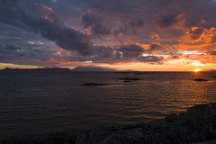 Sunset over the Scottish islands (Daniel Mortimer) Tags: uk blue sunset sea cloud sun beach water yellow rock clouds canon island scotland highlands europe horizon tripod dramatic sigma wideangle canon7dmarkii